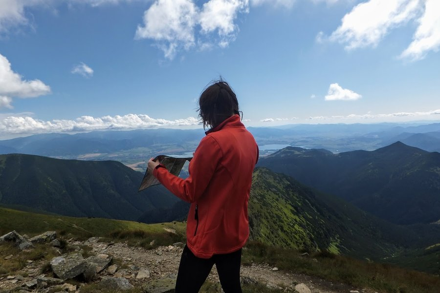 Reading a map while hiking in Western Tatra mountains, Slovakia