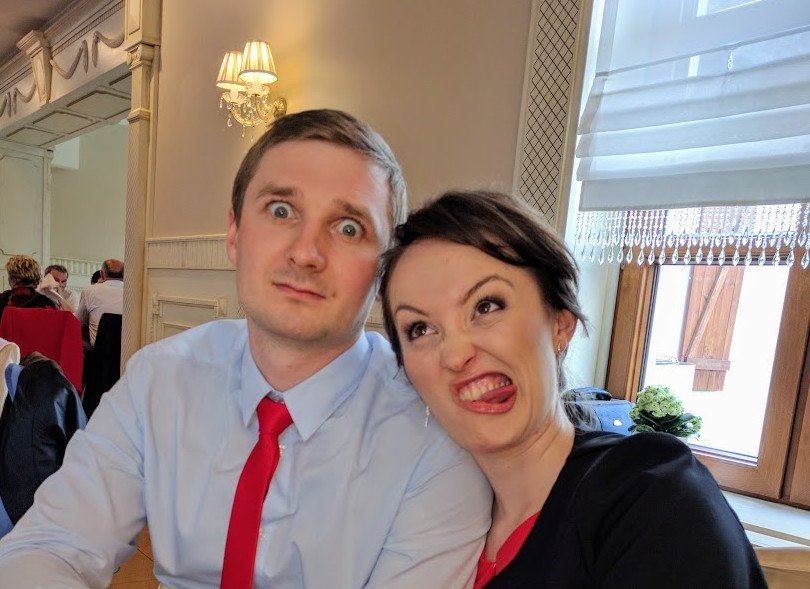 Young couple making funny face at a Polish wedding